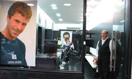 Hair salon with owner standing at door